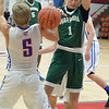 CCS' Jacob Martinez (1) has the ball knocked away from him by Open Door's RJ Stanford on Dec. 16.  STEVE MANHEIM / CHRONICLE
