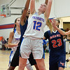 Open Door's Alissa Faber goes up for a rebound during Monday's game against Lincoln-West. STEVE MANHEIM / CHRONICLE