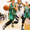Columbia's Torrie Shields works past Keystone's Haley Sprouse on Monday. JOE COLON / CHRONICLE