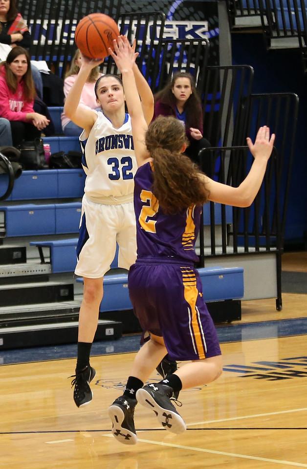 Brunswick's Eileen Salisbury puts up a shot over St. Joseph Academy's  Colleen Drellishak during the third quarter. AARON JOSEFCZYK/GAZETTE