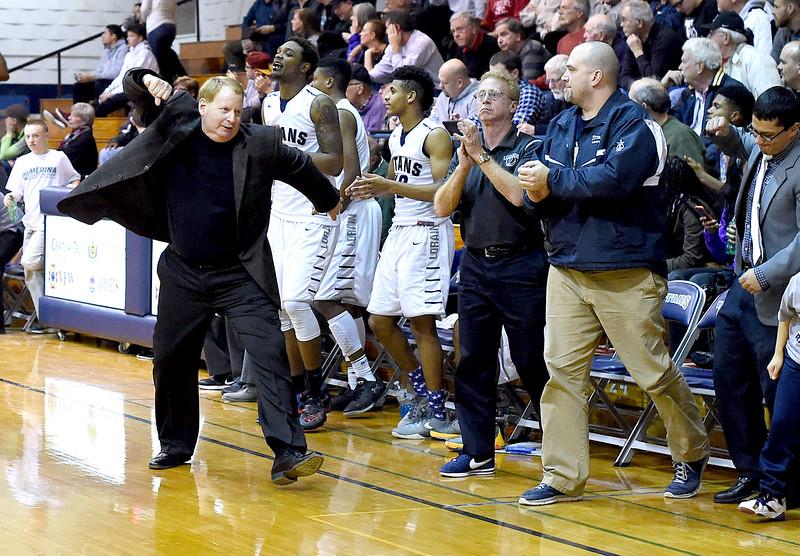 KRISTIN BAUER \ GAZETTE Lorain High School varsity basketball head coach John Rositano celebrates a win against Medina that Lorain clinched in the final period of the game on Tuesday, Jan. 19.