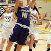 Vermilion's Caitlyn Schnur drives to the hoop past Clearview's Samantha Jancsura on Dec. 12. STEVE MANHEIM / CHRONICLE
