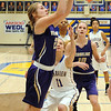 Vermilion's CeCe Dillion eyes the basket as Clearview's Samantha Jancsura defends Monday night.   STEVE MANHEIM / CHRONICLE