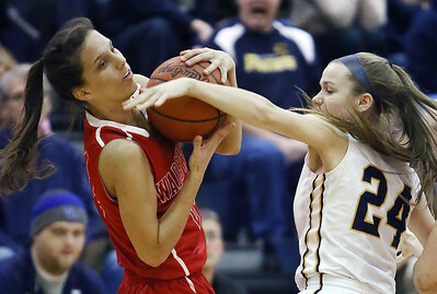 Wadsworth's Jenna Johnson steals the ball from Whitmer's Maddie Brown during the second quarter. (RON SCHWANE / GAZETTE)