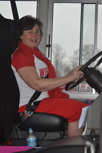 ASHLEY FOX / GAZETTE Desi Bradford, a bus driver in the Wadsworth school district for 19 years, gets ready to drive the Lady Grizzlies to Columbus on Thursday morning. Bradford likes to watch teams compete and is excited to drive the team to the tournament.