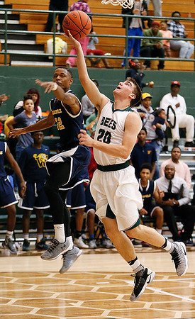 Medina's Colin Szumski shoots against Warrensville's Travis Torian during the second quarter. (RON SCHWANE / GAZETTE)