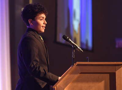 KRISTIN BAUER | CHRONICLE   Marion L. Steele High School's Christian Velez speaks on Tuesday night, March 7 during the Mike Cleary Northeastern Ohio Chapter of the National Football Foundation after accepting the Inspiration Award.