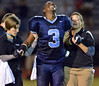 North Penn's Kris Akins ,3, shows his pain as he is assited off the field by trainers after being injured during the Knights game against  Archbishop Wood  first half action of their contest at North Penn High School.  Friday September 6,2013. Photo by Mark C Psoras/The Reporter