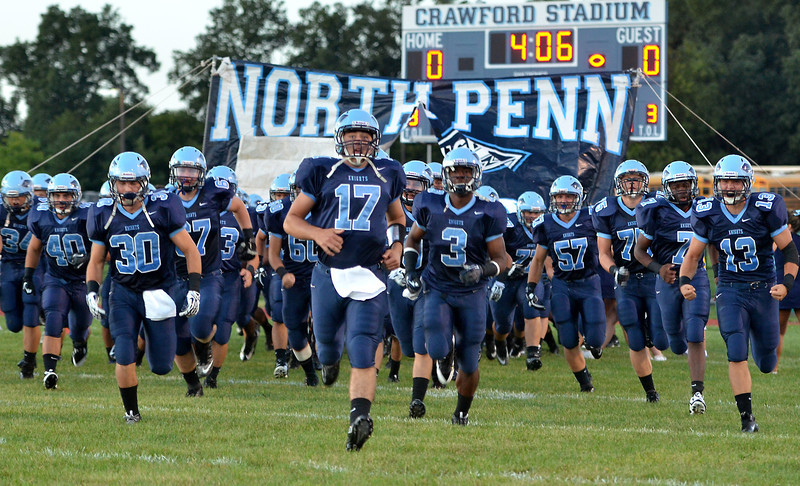 The North Penn Knights Football Team takes the field for their contest against  Archbishop Wood defenders during first half action of their contest at North Penn High School.  Friday September 6,2013. Photo by Mark C Psoras/The Reporter