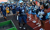 Kris Akins ,3, and the North Penn Knights Football team are cheered on as they take the field before their contest against  Archbishop Wood defenders during first half action of their contest at North Penn High School.  Friday September 6,2013. Photo by Mark C Psoras/The Reporter