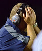 North Penn Head Coach Dick Beck covers his face during the Knights loss to Archbishop Wood at North Penn High School.  Friday September 6,2013. Photo by Mark C Psoras/The Reporter
