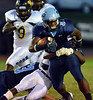 North Penn's Kris Akins ,3, is wrapped up by Archbishop Wood defenders after a short gain during first half action of their contest at North Penn High School.  Friday September 6,2013. Photo by Mark C Psoras/The Reporter