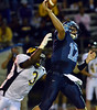 North Penn' quaterback Austin Shearer,17, releases a pass as he is pressured by Archbishop Wood defender Chris Gary ,3, during first half action of their contest at North Penn High School.  Friday September 6,2013. Photo by Mark C Psoras/The Reporter