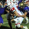 Firelands Patric Keown is tackled by Vermilion Brock Naill, left, and Paul Knox in second half Sep. 9. Steve Manheim