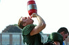 A member of the Lansdale Catholic football team takes a drink of water during a short break in practice.   Monday,  August 11, 2014.   Photo by Geoff Patton