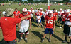 Assisant coach Wayne McFarland talks to players during Souderton Area High School football practice.   Monday, August 11, 2014.   Photo by Geoff Patton