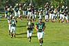 Members of the Landale Catholic football team run onto field following a short break in practice.    Monday, August 11, 2014.    Photo by Geoff Patton