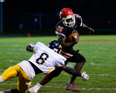 Elyria's Tymaine Jackson avoids a tackle by Euclid's Cam King Friday Night. JESSE GRABOWSKI / CHRONICLE