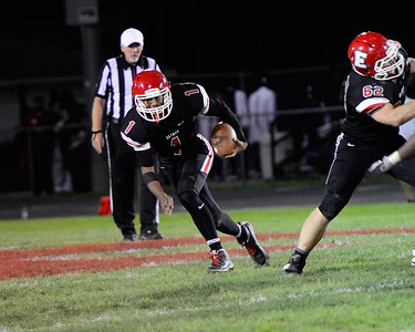 Elyria's Donte Beckett keeps the ball and runs for yards against Euclid Friday. JESSE GRABOWSKI / CHRONICLE