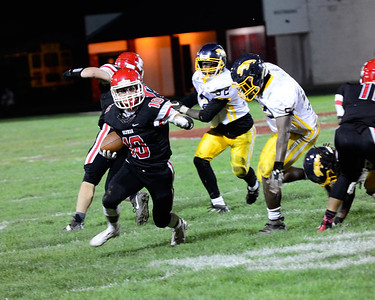 Elyria Junior Brendon Fenton carries the ball for a gain in their game against Euclid Friday. JESSE GRABOWSKI / CHRONICLE