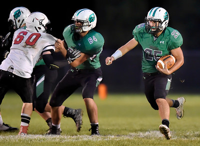 Columbia tackle Jagger Schmidt (64) blocks for Mike Jacobucci against Lutheran West. DAVID RICHARD / CHRONICLE