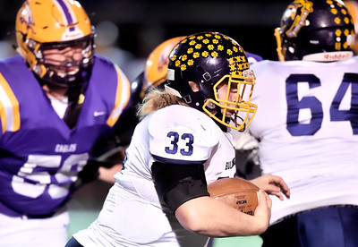 Spencer Linville of Olmsted Falls rushes against Avon. DAVID RICHARD / CHRONICLE