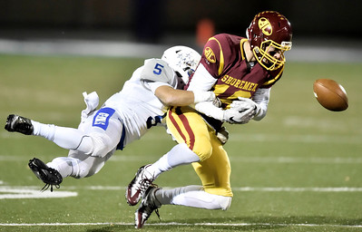 Caleb Burr of Avon Lake fumbles the ball while defended by Anthony Wayne's Cooper Heck. DAVID RICHARD / CHRONICLE