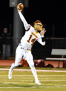 KRISTIN BAUER | CHRONICLE Avon Lake High School senior quarterback Mark Pappas (14) makes a pass during a game against Avon High School on Friday night, Nov. 4.