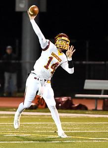KRISTIN BAUER | CHRONICLE Avon Lake High School senior quarterback Mark Pappas (14) makes a pass during a game against Avon High School on Friday night, Nov. 4.