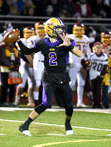 KRISTIN BAUER | CHRONICLE Avon High School senior quarterback Matt Kelly (2) makes a pass during a game against Avon Lake High School on Friday night, Nov. 4.