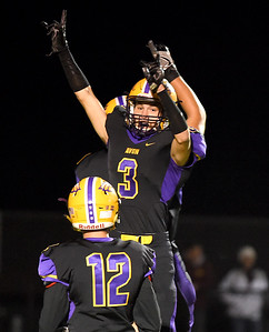 KRISTIN BAUER | CHRONICLE Avon High School senior Tyler Nelson (3) jumps to celebrate a touchdown during a game against Avon Lake High School on Friday night, Nov. 4.