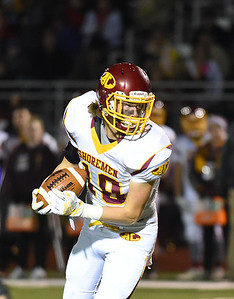 KRISTIN BAUER | CHRONICLE Avon Lake High School senior wide receiver Michael Davis (18) carries the ball during a game against Avon High School on Friday night, Nov. 4.