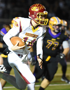 KRISTIN BAUER | CHRONICLE Avon Lake High School senior quarterback Mark Pappas (14) carries the ball during a game against Avon High School on Friday night, Nov. 4.