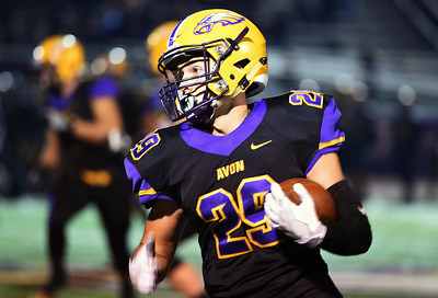 KRISTIN BAUER | CHRONICLE Avon High School senior running back Mason McLemore (29) carries the ball during a game against Avon Lake High School on Friday night, Nov. 4.