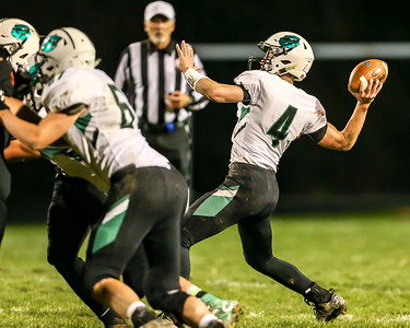 Columbia's Cody Schwartz drops back to pass against Springfield in a playoff game Friday. JOE COLON / CHRONICLE