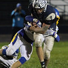 ANNA NORRIS/CHRONICLE<br /> Lorain running back Aaron Huff runs the ball up the middle for a gain of yards as Olentangy's Braydon Chitty makes the tackle in the second half of the first round of playoffs in Division I at George Daniel Stadium in Lorain Friday night.