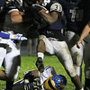 ANNA NORRIS/CHRONICLE<br /> Lorain running back Carlos Chavis charges through the Olentangy defense for the gain of yards in the second half of the first round of the Division I playoffs Friday night at George Daniel Stadium in Lorain. The Titans beat Olentangy 34-14.