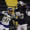 ANNA NORRIS/CHRONICLE<br /> Lorain wide receiver Daesean Brooks catches the ball from quarterback Justin Sturgill for the first down in the fourth quarter against Olentangy in the first round of the Division I playoffs Friday night at George Daniel Stadium in Lorain.