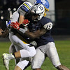 ANNA NORRIS/CHRONICLE<br /> Lorain outside linebacker Naz Bohannon tackles Olentangy's Ian Drummond on the run in the first half of the first round of the Division I playoffs at George Daniel Stadium in Lorain Friday night.