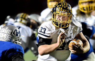 Spencer Linville of Olmsted Falls rushes against Midview in the first quarter. DAVID RICHARD / CHRONICLE