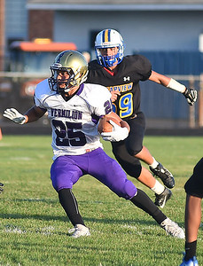 KRISTIN BAUER | CHRONICLE Vermilion High School junior wide receiver Eli Balek (25) takes the ball down the field as Clearview High School sophomore offensive lineman Julian Colbert trails behind on Friday night, Aug. 26.