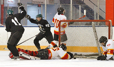 01/18/10 Amherst #22 Connor Morris ??? has just scored Amherst goal in  first quarter. amherst #11 Shamus Miller. Brecksville #10 is Mike Sullivan. The Brecksville goalie is #33 Johnny Miller and at right is #12 Aaron Gerow. Photo by Tom Mahl