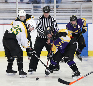 Face-off between Amherst's Paul Miller (25) and Avon's Nick Stevens (8). photo by Ray Riedel