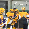 KRISTIN BAUER / CHRONICLE<br /> Avon Lake High School's Conner Koneflik (6) is congratulated by teammates after scoring a goal on Saturday, February 10 during a game against Lakewood.