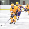 KRISTIN BAUER / CHRONICLE<br /> Avon Lake High School's Conner Koneflik (6) takes the puck down towards the goal as Lakewood High School's Jared Yocatet (10) guards him on Saturday, February 10.