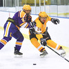 KRISTIN BAUER / CHRONICLE<br /> Avon Lake High School's Joey Kleinhinz (28) and Lakewood High School's Payton Neal (2) battle for control of the puck on Saturday afternoon, February 10.