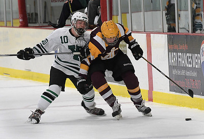 Westlake's Sam Mansour battles Avon Lake Shoreman Nick Ospelt for the puck during Sunday's matchup at Hamilton Ice Arena in Rocky River. BILL KEATON / CHRONICLE