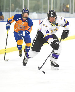 KRISTIN BAUER | CHRONICLE   Avon High School's Zach Zwierecki (19) slaps the puck into the goal as NDCL's Connor Zoul (8) trails behind on Friday evening, Feb. 10.