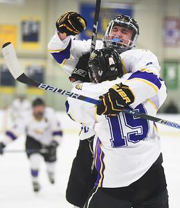 KRISTIN BAUER | CHRONICLE   Avon High School's Zach Zwierecki (19) celebrates a goal with Gabe Intagliata (9) on Friday night, Feb. 10 against NDCL.