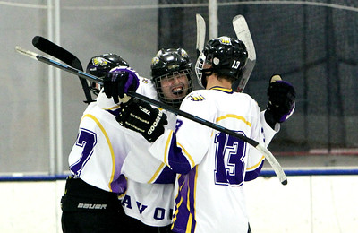 ANNA NORRIS/CHRONICLE Avon's Alex Provenza, center, celebrates Ian Dargai's goal against Olmsted Falls with team mates Jarett Greene (17) and Jake Folds (13) in the second period of the first semifinal game of the Southwest Conference tournament at North Olmsted Rec Sunday afternoon.